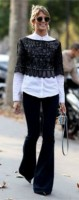 flared jeans in black with white top and black lace