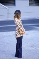 flared jeans with animal print long sweater