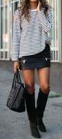 passe style mini skirt with knee high boots in black