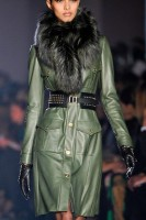 Jason Wu green leather dress, black studded gloves and fur scarf