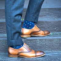 men's suit style blue print socks with gray suit and brown oxfords
