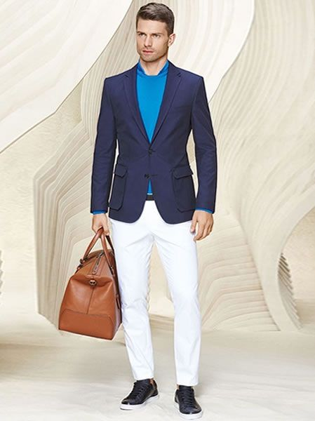 What to pack for business travel, men's travel outfit white pants, navy blazer, blue sweater