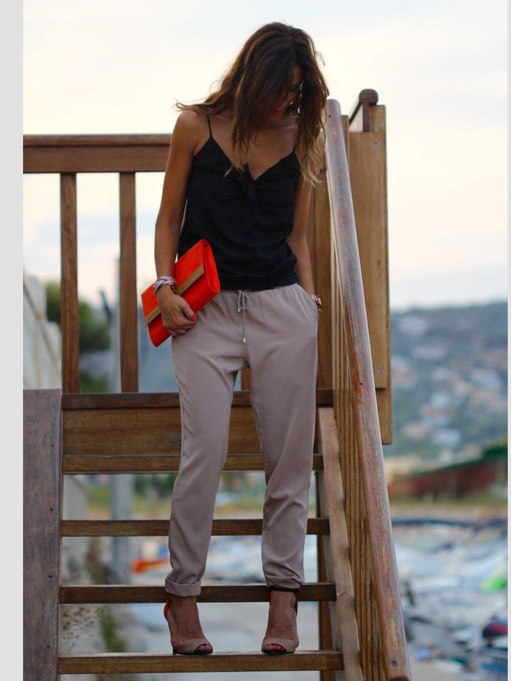 harem pants with orange handbag