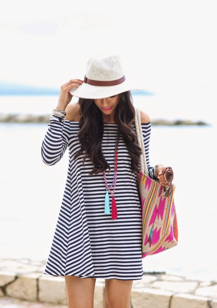 off the shoulder striped dress and hat with beach bag