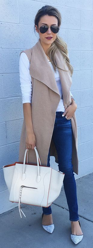 denim with long camel colored vest