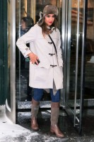 Jessica Alba wearing boots and white coat in the snow