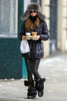 Olivia Palermo puffer jacket, leather leggings and fur pom pom boots
