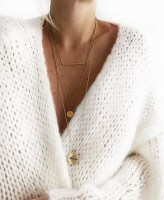 necklace layers white sweater