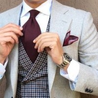 Men's suit style light gray suit jacket with plaid vest and burgundy tie