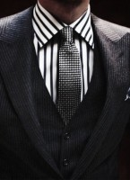 men's pinstriped suit and print shirt