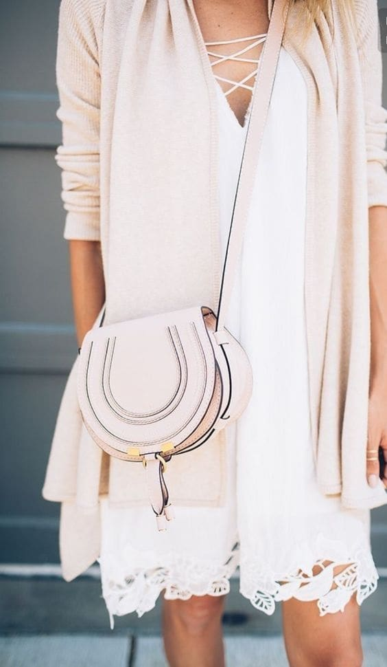 blush pink sundress with cardigan and crossbody bag
