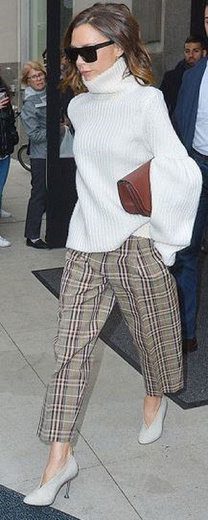 Fall prints...plaid. Victoria Beckham in plaid pants, light gray high heel booties and cream turtleneck sweater