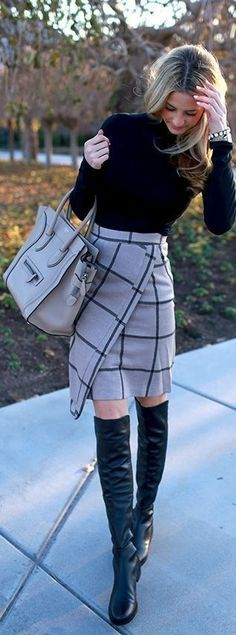 Boots at the Office, plaid skirt, black over the knee boots and black top, winter officewear