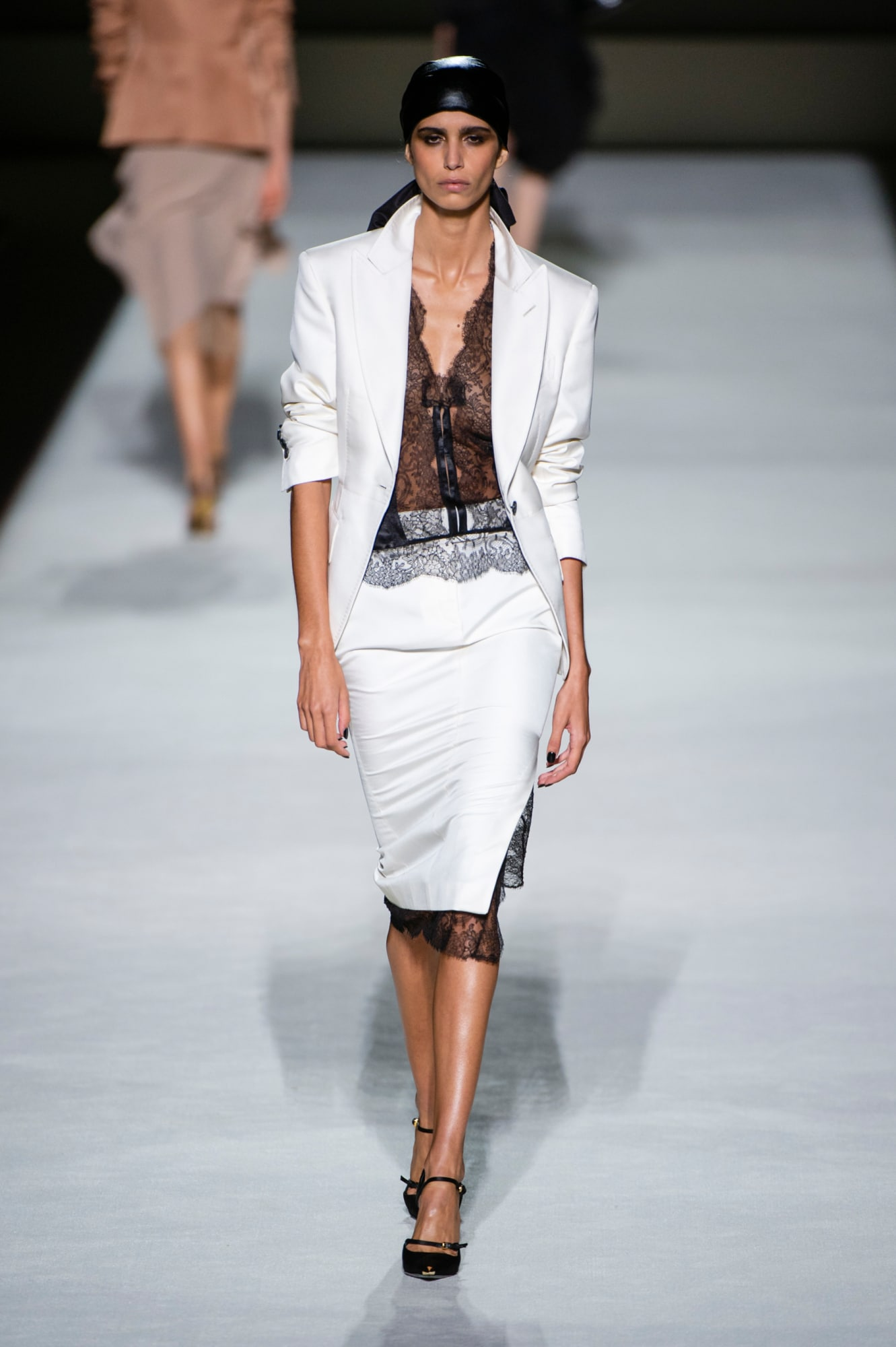Tom Ford spring 2019 collection, women's white suit with black lace