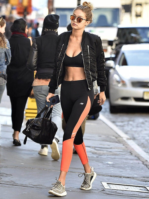 Women's Stylish Workout Attire, bomber jacket, Gigi Hadid black bomber jacket with zippers, black and peach leggings
