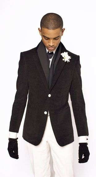 Men's holiday style, men's holiday black tie event outfit, men's winter white trousers, black tuxedo blazer, scarf and gloves