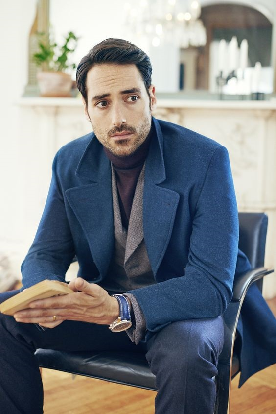 Men's holiday style, what to wear to casual holiday party, men's blue overcoat, black turtleneck, gray blazer and jeans