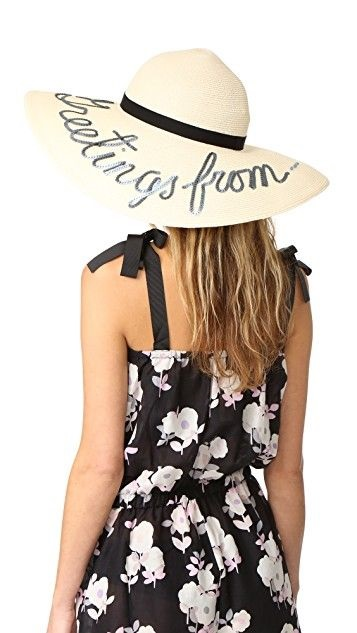 The Best Trends in Spring Summer Hats, vacation-ready hat, sunhat with phrase, Eugenia Kim