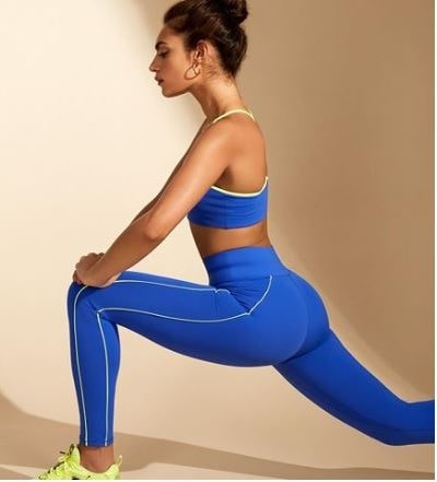 Sequester Style What to Wear When Stuck at Home, bold bright workout gear, All Access blue with lime trim leggings sports bra, Bandier